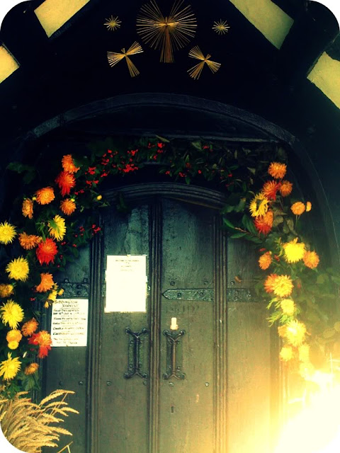 Church door decorated for harvest