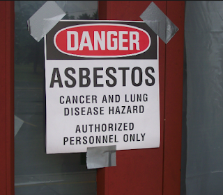 asbestos exposure warning sign