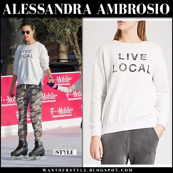 Alessandra Ambrosio in white sweatshirt and camo pants ice skating winter fashion december 8