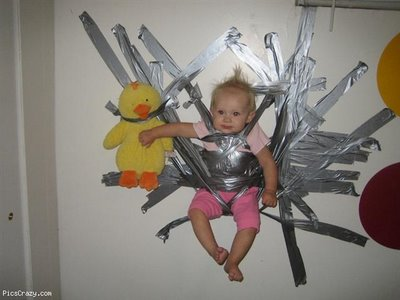 Baby duct taped to a wall