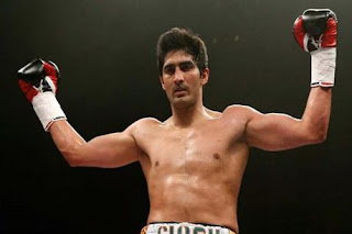 Vijender defeats Chinese boxer Momtali, win consecutive 9th match