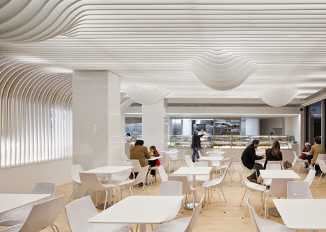 white wavy slats structure wall cafe