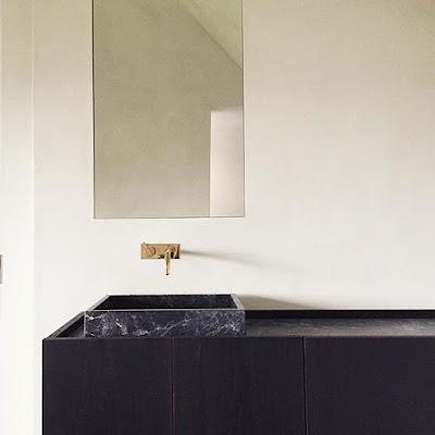 Dark stone in the bathrooms