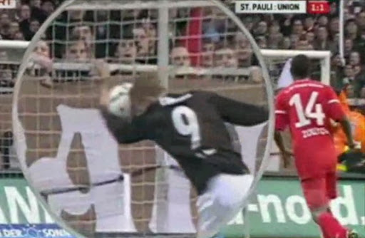 St Pauli striker Marius Ebbers uses his hand to score a goal against Union Berlin