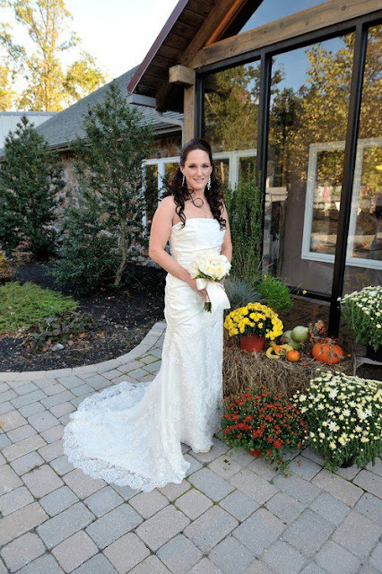 bride outside with mums