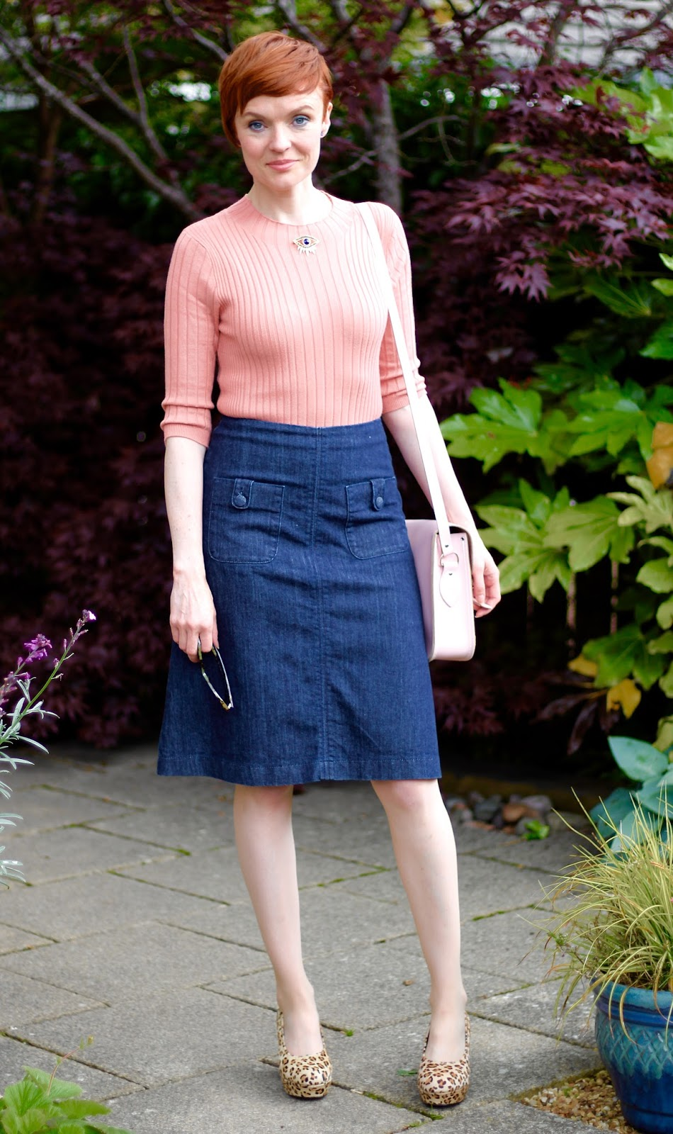Fake Fabulous | Is it time for your style to grow up? | Denim A-line skirt, leopard platform shoes and an eye brooch.
