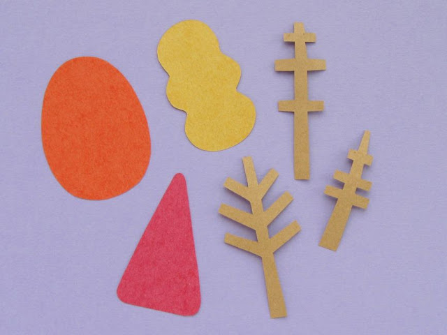 cutting out tree shapes for an autumn card