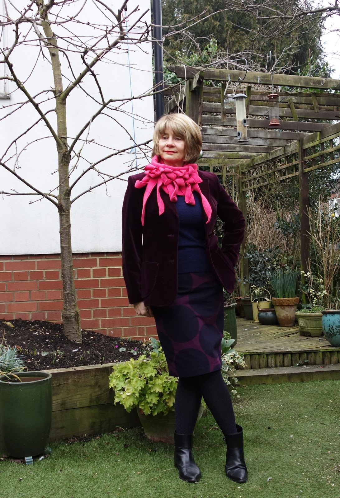 Burgundy velvet jacket worn with striking Rew scarf