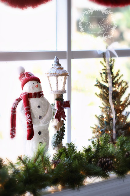 The bay window has been filled with snowmen, Christmas trees and garland.