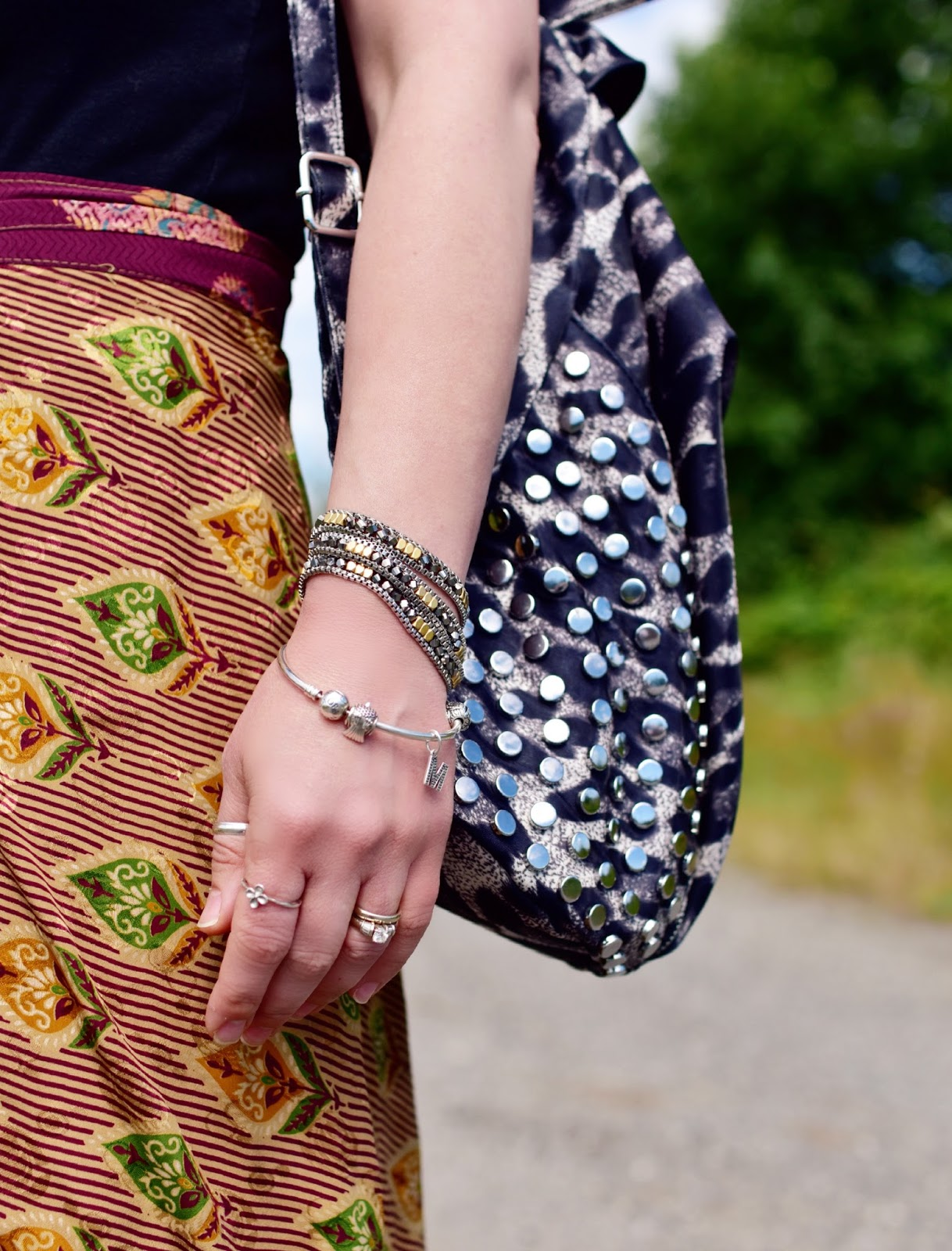 silk wrap skirt, leopard-patterned backpack