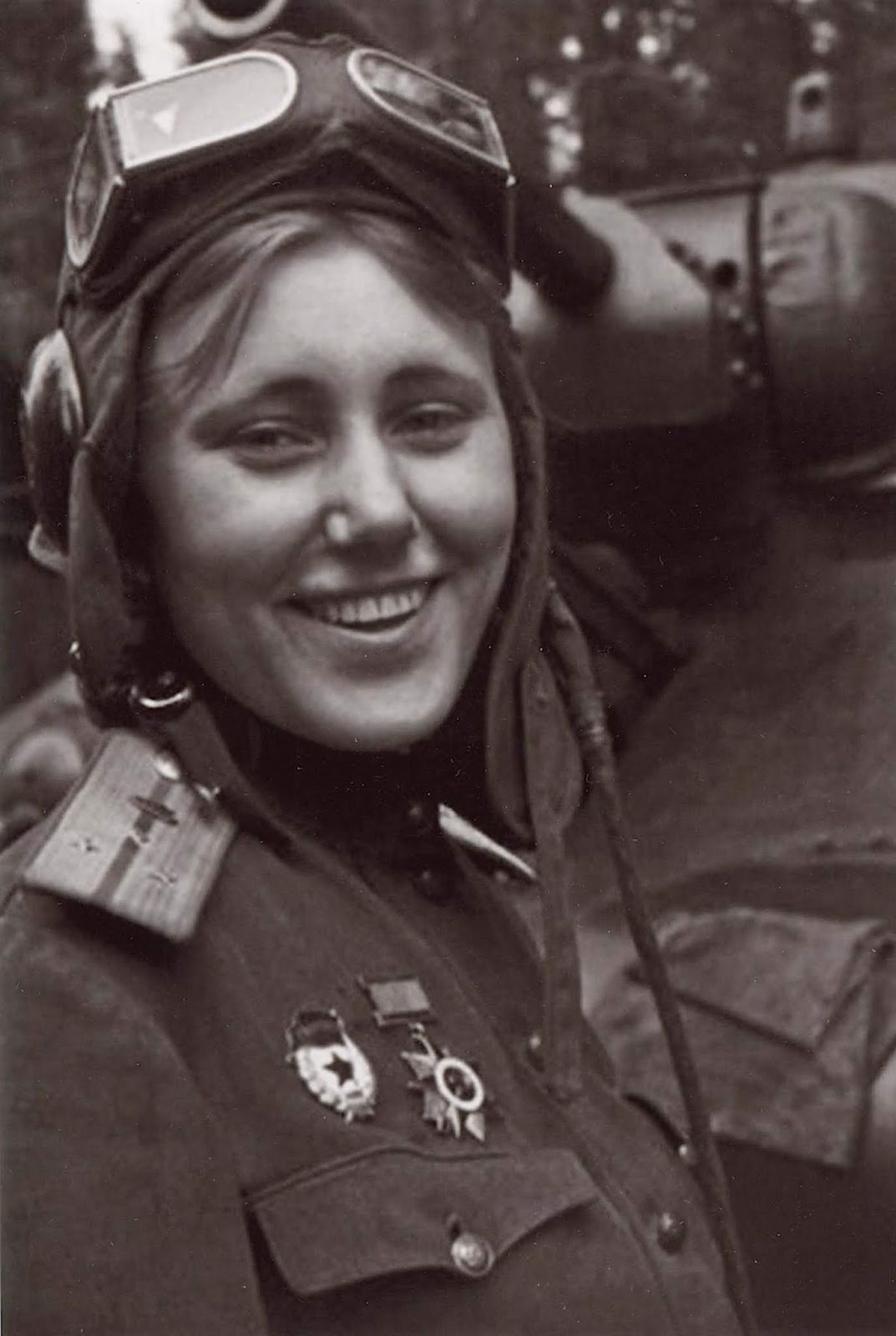Aleksandra Grigoryevna Samusenko was a Soviet commander of a T-34 tank and a liaison officer during World War II. She was the only female tankman (tankwoman?!) in the 1st Guards Tank Army. She is here because she had the prettiest smile in the 1st Guards Tank Army. You can read more about her on this article.