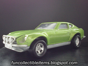 Green Datsun toy rally car.