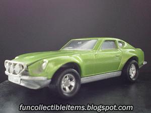 Green Datsun toy rally car.