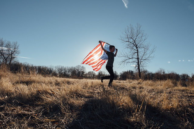 child and american flag
