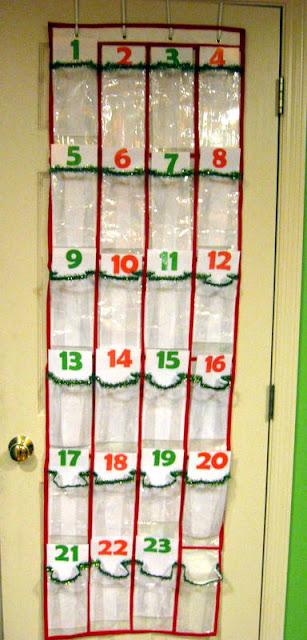 A homemade Grinch advent calendar made of a plastic shoe organizer