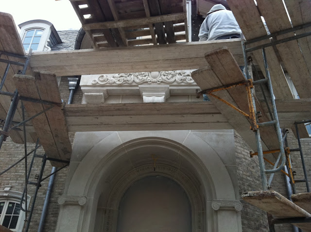 Under construction front entrance with limestone architecture at Enchanted Home chateau