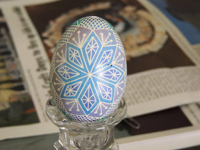 Pysanky egg with diamond pattern in blues and pinks