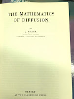 The title page of The Mathematics of Diffusion, by John Crank, superimposed on Intermediate Physics for Medicine and Biology.