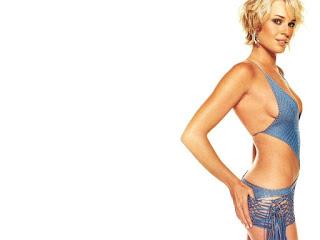 Rebecca Romijn Holding Her Bump In Bikini