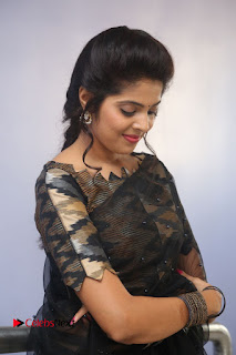 Actress Shravya Pictures in Black Saree at Nandini Nursing Home Audio Success Meet 0108