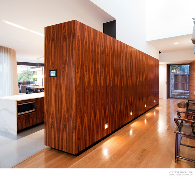 Wooden kitchen wall in the River House by MCK Architects