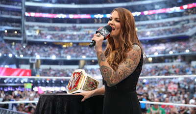 Lita with the WWE Women's Championship belt