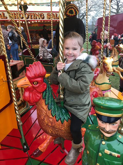 My niece enjoying a ride on Carters Steam Fair Dobbies ride.