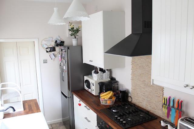 white ikea kitchen with dark wood worktops