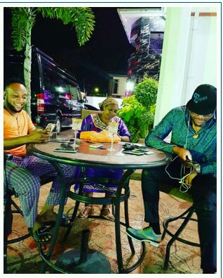 kcee, E-money and their Mon hangs sits outside their mansion