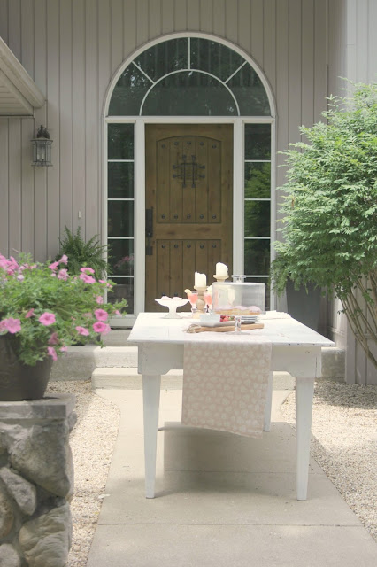 Farm table in French inspired pea gravel courtyard - Hello Lovely Studio