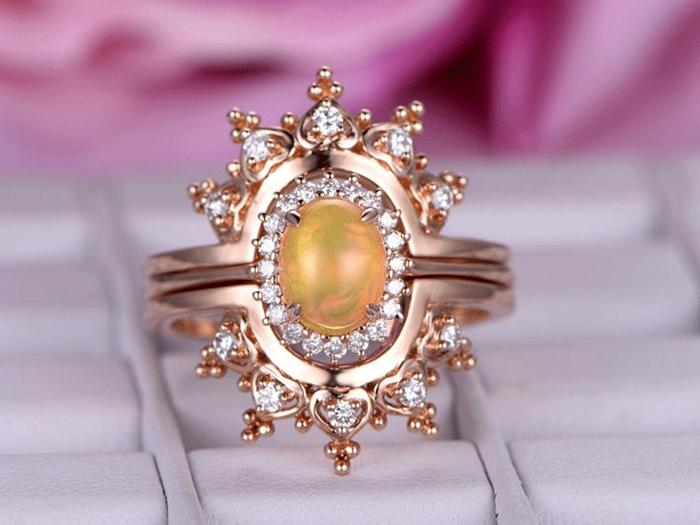 https://www.bbbgem.com/3-pc-6x8mm-oval-cut-opal-engagement-ring-set-14k-rose-gold-diamond-band-stackable-bezel-set-wedding-band-curved-crown-half-eternity-pave-set/