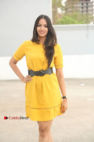 Actress Poojitha Stills in Yellow Short Dress at Darshakudu Movie Teaser Launch .COM 0026.JPG