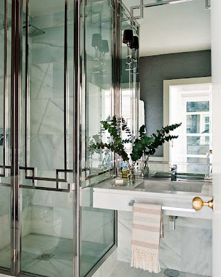 bathroom in black and white with marble sink and chrome shower doors via belle vivir blog