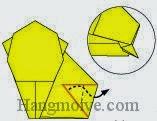Bước 11: Gấp góc giấy ra ngoài nhưng vẫn ở trong hai lớp giấy. (Xem thêm Video)