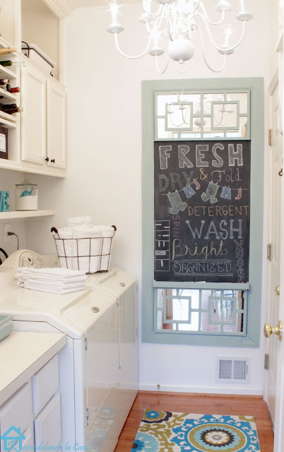 chalkboard with added mirrors in laundry room white and blue