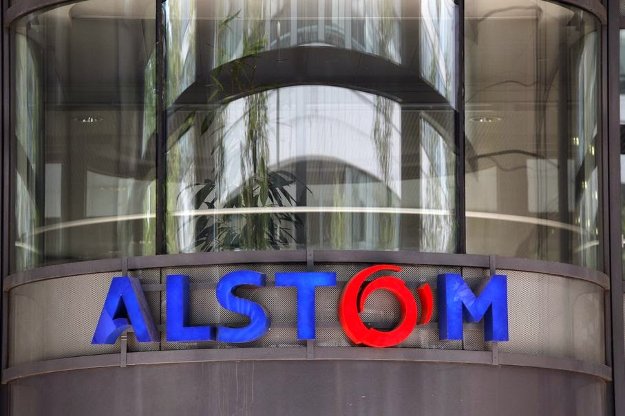 This Wednesday, April 30, 2014 file photo shows the company logo of Alstom at the headquarters of the leading global maker of high-speed trains, power plants and grids, in Levallois-Perret, outside Paris, France. Engineering giants Siemens of Germany and Mitsubishi Heavy Industries of Japan on Monday June 16, 2014 jointly offered to buy parts of France's Alstom and start a long-term partnership, a move that could derail a competing bid by General Electric.