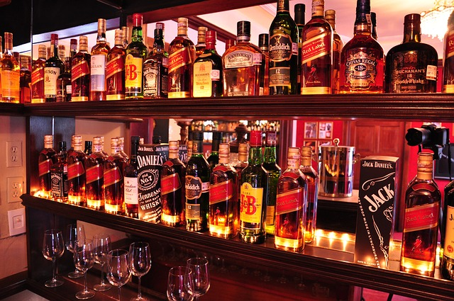 Different kinds of premium alcoholic drinks in a rack