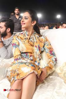 Actress Rakul Preet Singh Stills in Short Dress at Dhruva Pre Release Function  0035.JPG