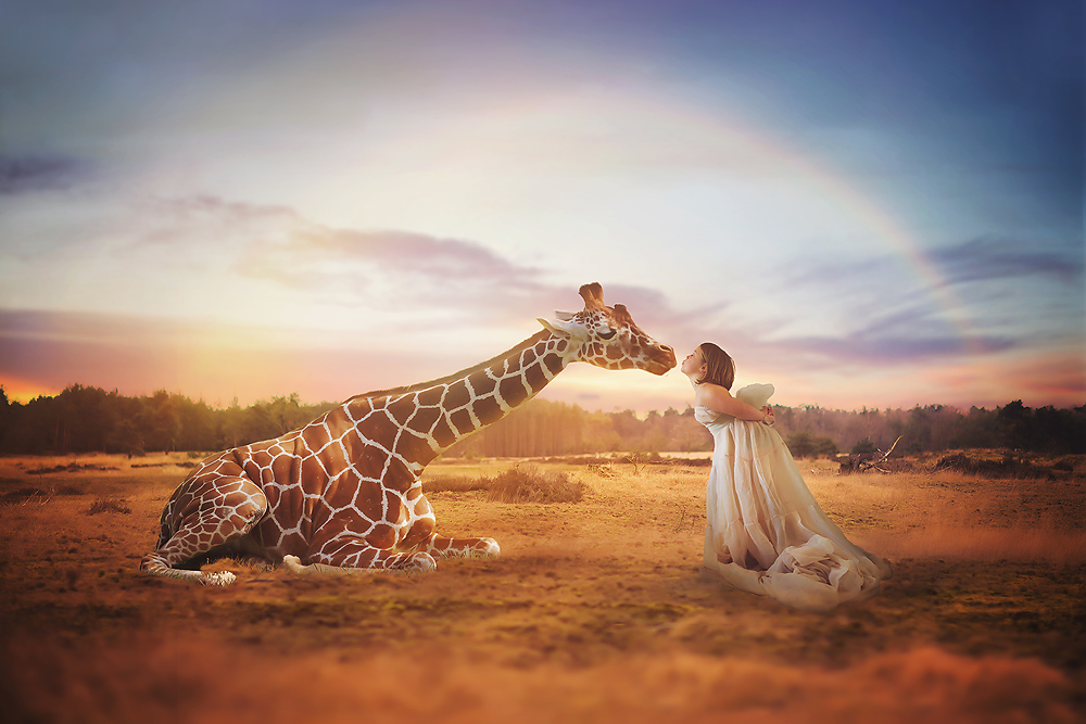conceptual fantasy image of a girl and a Giraffe