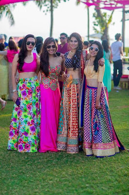 Group Of Indian Girls In Multi Colored Mehndi Lehenga With Polki Studded Bridal Necklace Set.