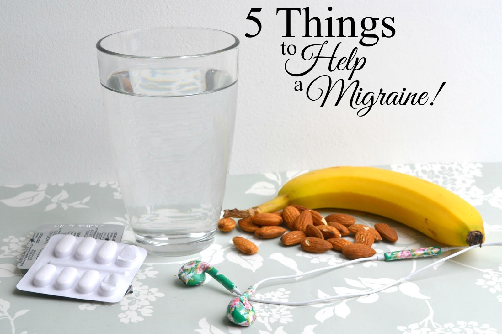 Migraine help: Painkillers, water, almonds, a banana and headphones.