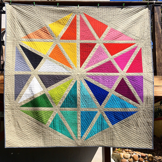 Giant Prismatic Medallion Quilt Designed by Susan Kephart for Robert Kaufman featuring fabrics from Kona Cotton Solids