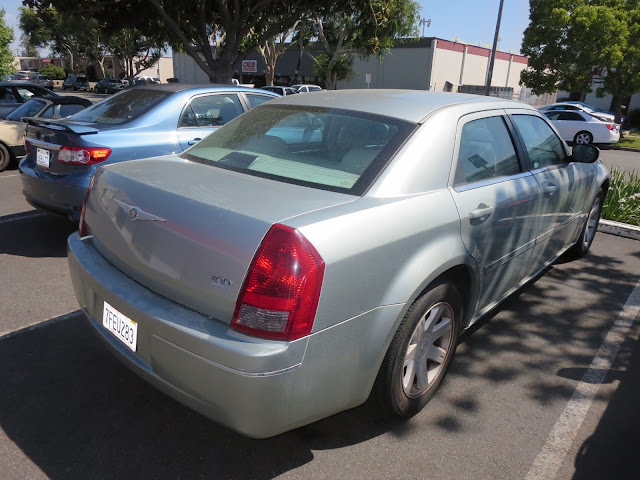 Automobile refinish from silver to black.