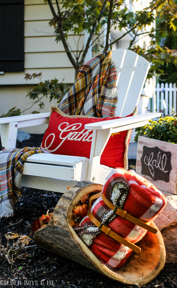 Outdoor fall decor ideas with plaid blanket, mums and adirondack chair