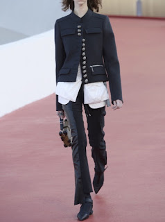 2017 Cruise Collection Louis Vuitton black military style jacket with one row of silver buttons over a white shirt and black trousers