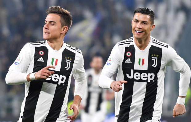 Juventus stars Paulo Dybala and Cristiano Ronaldo celebrating a goal
