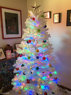 big white christmas tree... with bright baubles