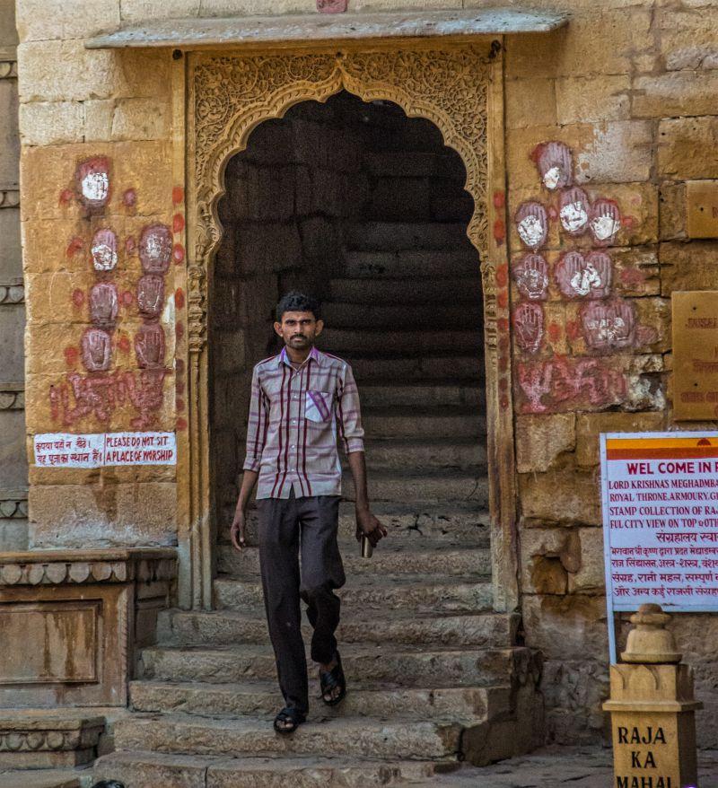 Door of the Raja Ka Mahal Jaisalmer Fort with imprints of the hands of Satis