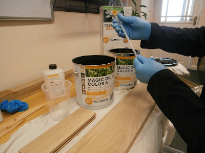 mixing a bespoke colour using Pallmann Magic Oil 2K on a sample piece of solid oak wood