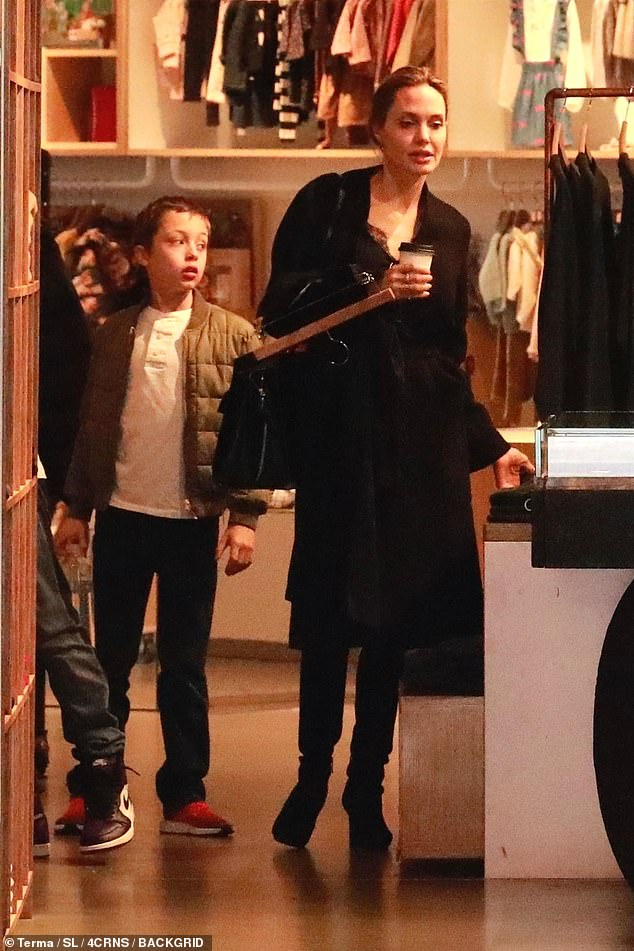 Angelina Jolie looks effortlessly chic as she goes on a shopping spree with sons Pax and Knox